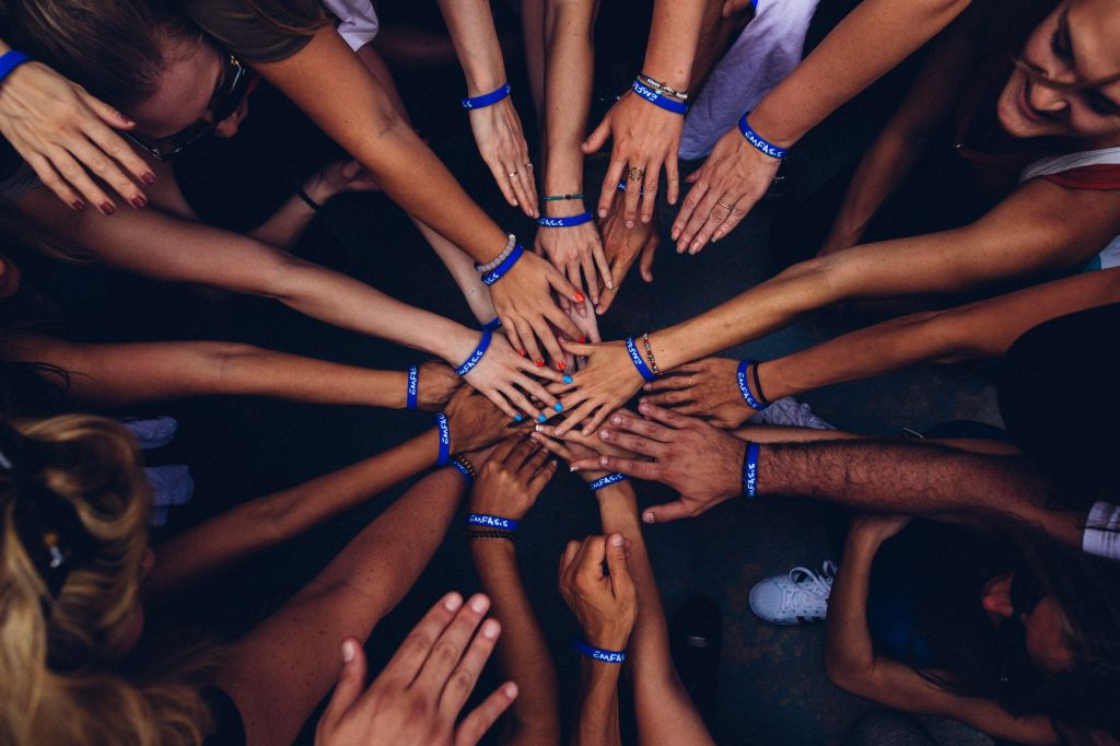 Photo of hands in a circle Photo by Perry Grone on Unsplash